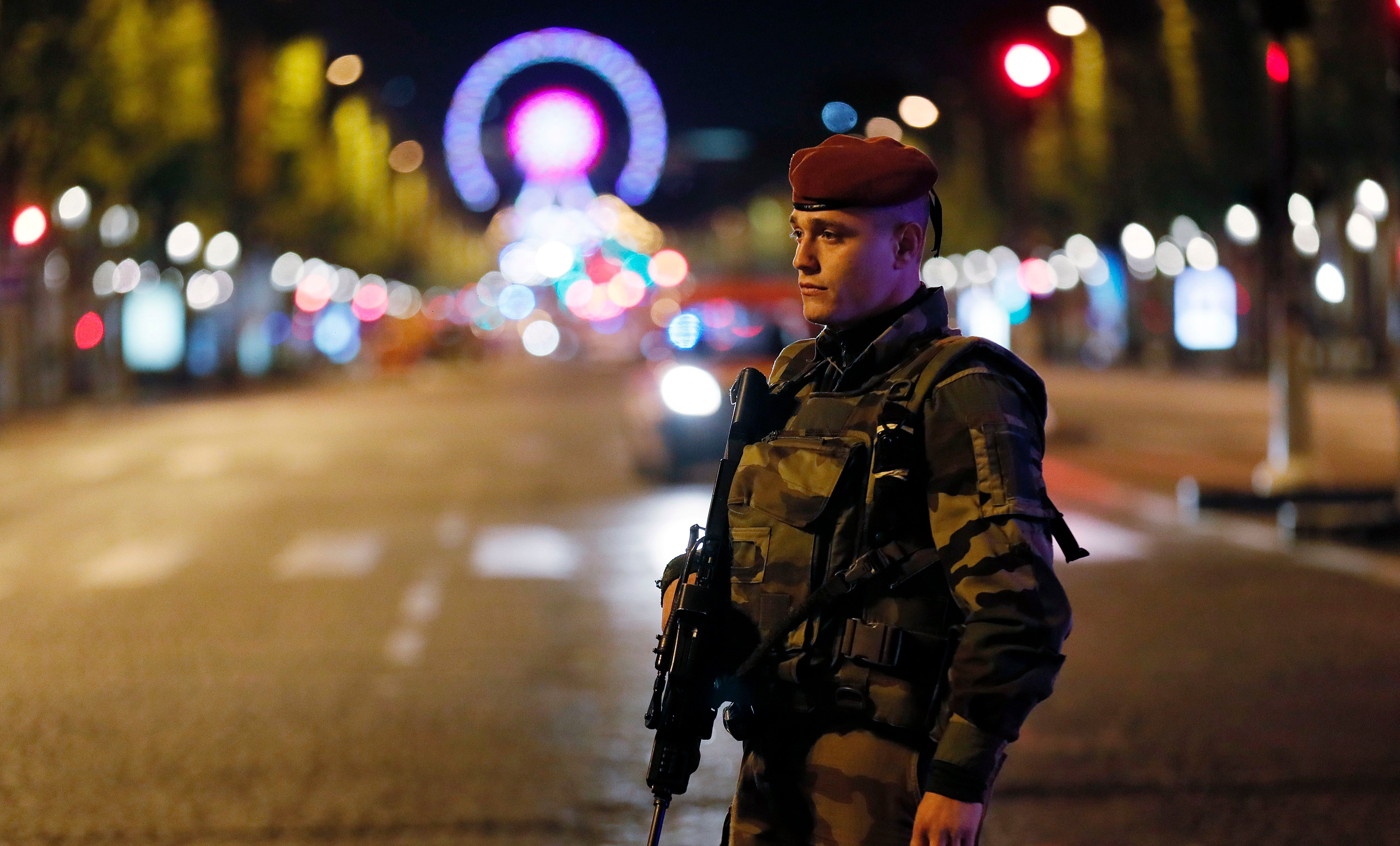 A French soldier stands guard on the Champs Elysees in Paris after a police officer was shot dead, April 20, 2017.