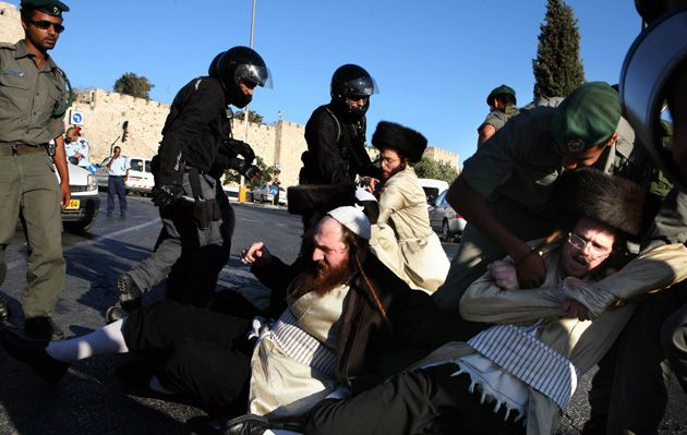 No Rest On Saturday: Ultra-Orthodox Jews clashed with police on July 11 in Jerusalem during protests over the opening of parking lots on the Sabbath.