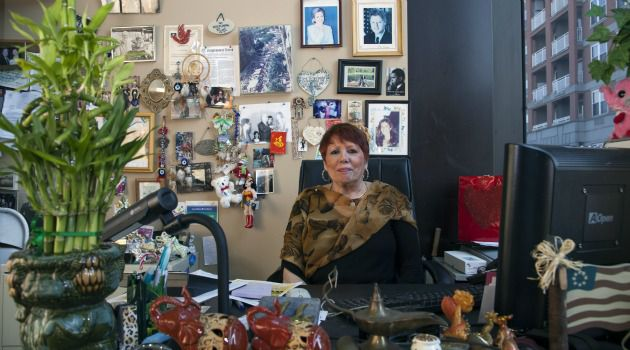 Mother Knows Best: Pat Singer, of the Brighton Neighborhood Association, has a desk filled with tchotchkes and a Rolodex filled with the names of public officials.