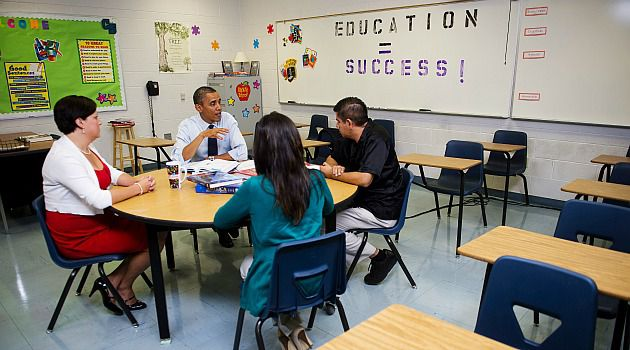 President Obama talks with teachers during a education roundtable at Canyon Springs High School in Las Vegas, Nevada, August 22, 2012.