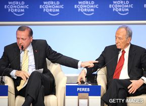 FINGER-POINTING: Turkish Prime Minister Recep Tayyip Erdogan, left, gestures at Israeli President Shimon Peres, claiming Israel ?murdered children on the beaches? of Gaza. Peres responded angrily to Erdogan?s remarks at the World Economic Forum at Davos, Switzerland, on January 29. Erdogan stormed off the stage when the moderator cut short his rebuttal.