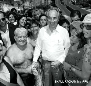 PERES: The Israeli leader showed his lighter side during a ?fun day? at a water park north of Tel Aviv during the run-up to the 1990 elections. Next to Peres: a look-alike ?double? of Yitzhak Shamir.