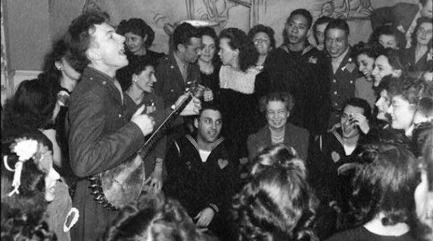 Hello, Mrs. President: Pete Seeger entertains an audience including Eleanor Roosevelt.