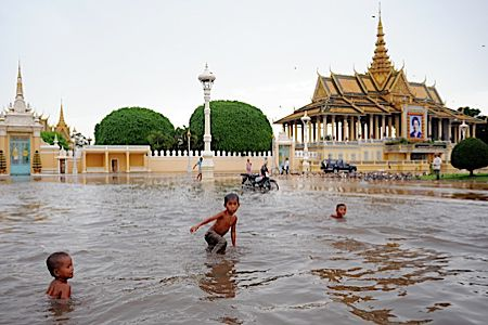 Cambodian boys play in the floodwaters, during the rainy season in Phnom Penh (click to enlarge)