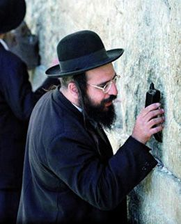 Can You Hear Me?: Some even talk to the Western Wall by phone.