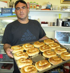 Fresh Borek: Pinchas Moshe, the owner of a Turkish restaurant in Yehud, Israel, displays a tray of pastries.