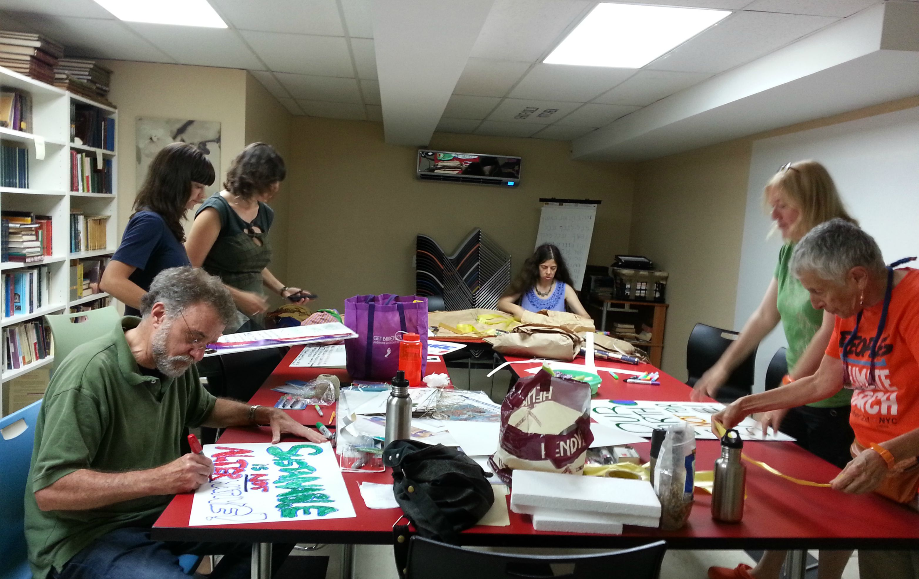 "Jewish activists preparing signs for the ""People's Climate March,"" which will be held September 21 in New York City."