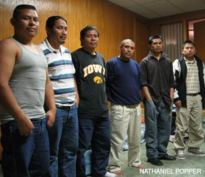 TRAPPED: Standing in their two-bedroom apartment on Postville's main street are six of the men who were arrested at Agriprocessors on May 12 and released October 14. From left, the men are Elder Lopez, Jonas Ordonez, Josway Muh-Exan, Rigoberto Quiej, Gabriel Calicio and Mario Toma.