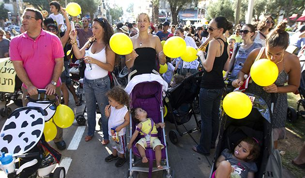 Stroller March: At a July 28 demonstration, parents in Tel Aviv protest against the high cost of living.