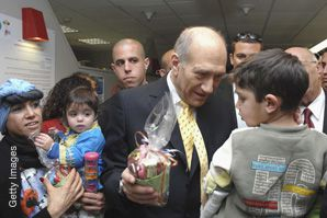 Bundle of Joy: Last Purim, Israeli Prime Minister Ehud Olmert handed out the food parcels known as mishloach manot. A new fee imposed by the Israel Postal Company is making the sending of such parcels from abroad prohibitively expensive.
