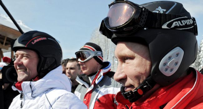 Russian president Vladimir Putin and former president Dmitry Medvedev prepare to ski at the Rosa Khutor apline ski resort in Krasnaya Polyana, just outside of Sochi.