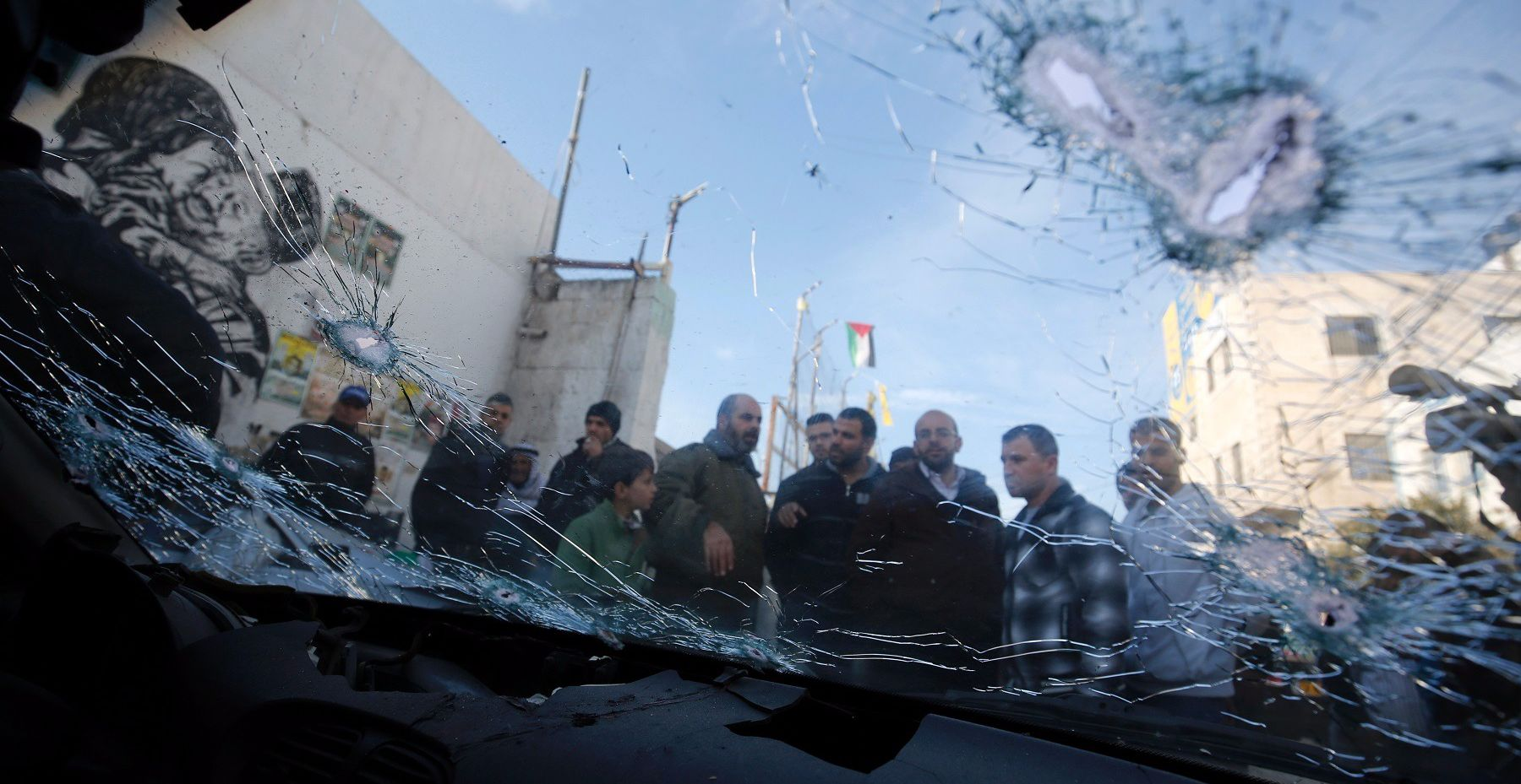 Israeli security forces shot dead two Palestinians who tried to ram them with their cars during an arrest raid in the West Bank Wednesday, the Israeli army and police and Palestinian medical sources said.
