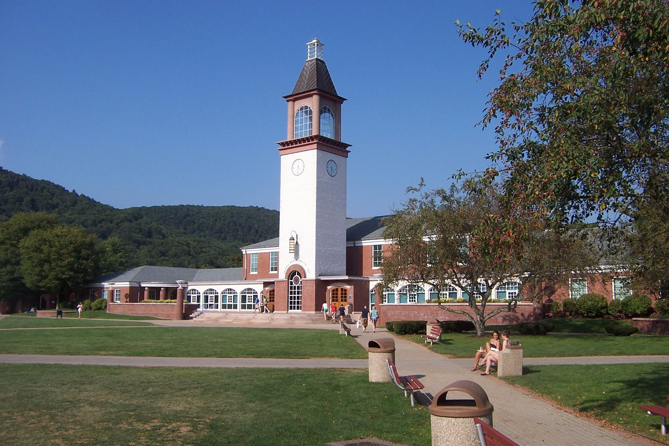 Quinnipiac University's Arnold Bernhard Library and clock tower, with Sleeping Giant in background.