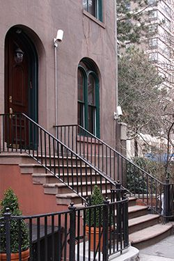 Home: The Manhattan townhouse where the rabbi and his family live is in foreclosure.