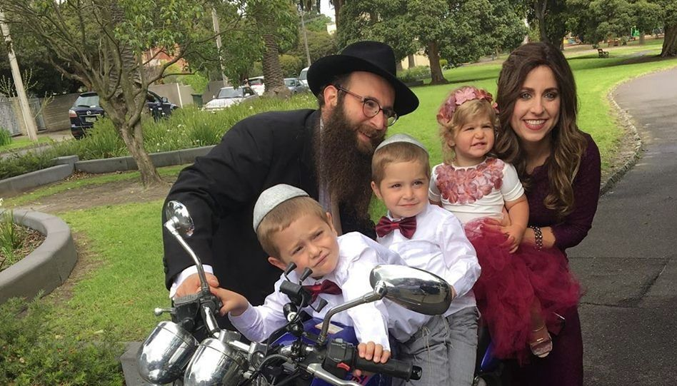 Rabbi Chaim and Rochel Telsner and children.
