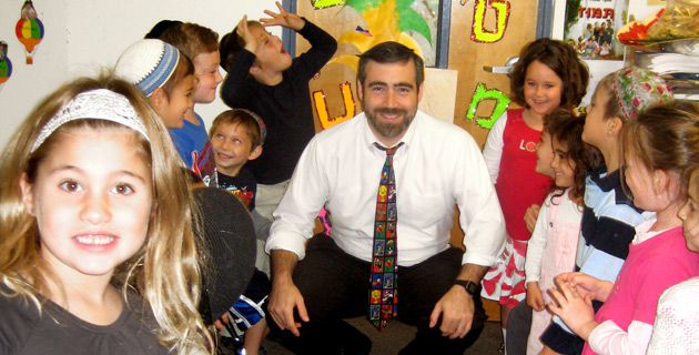 Back to School: After searching for a job, Rabbi Avi Greene found work as a principal at the Epstein Hebrew Academy in St. Louis, his hometown.