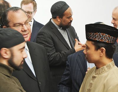 Talking the Talk: At a recent meeting convened by the Foundation for Ethnic Understanding, Rabbi Marc Schneier (center left) speaks with Imam Khalid Latif (left) and Imam Shamsi Ali (right).