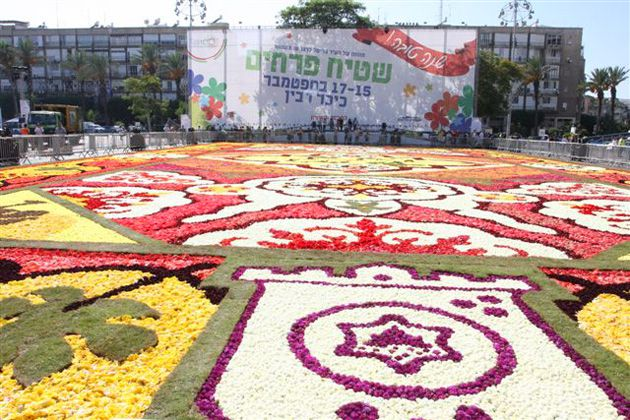 Floral Gift: A half million flowers from Brussels cover Tel Aviv?s Rabin Square, a birthday present from the Belgian city to mark Tel Aviv?s 100th anniversary.