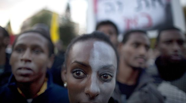 Black and White: An Israeli Jew of Ethiopian origin, with a painted face, takes part in a January 2012 protest in front of the Knesset against racism and discrimination.