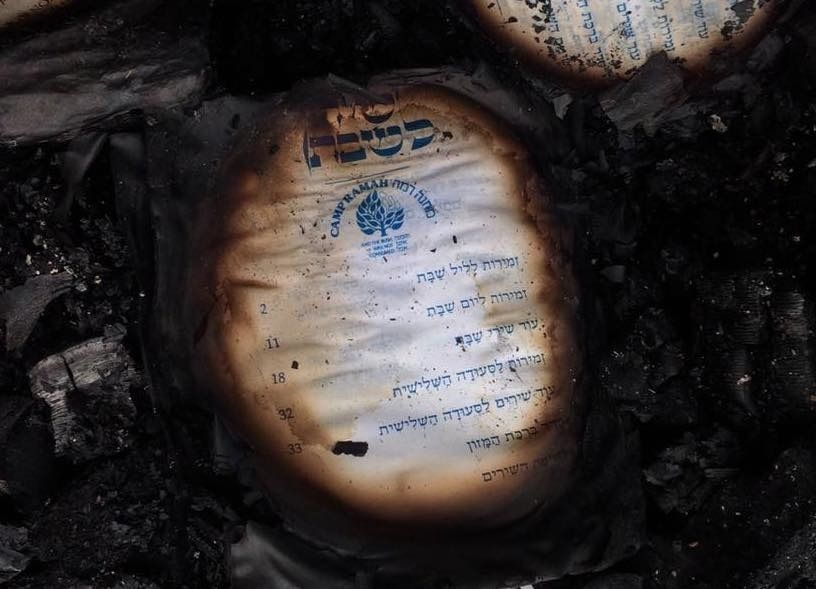 Burned prayer books found after the Ramah Rockies fire.