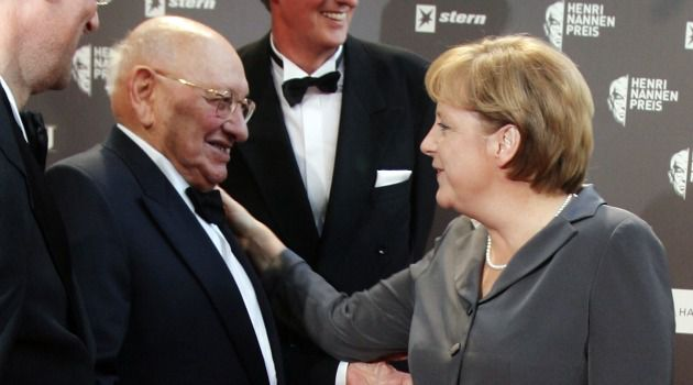 Meeting the Pontiff: Marcel Reich-Ranicki, seen here with Angela Merkel, survived World War II to become a post-war specialist in German literature and host of a German literary TV show.