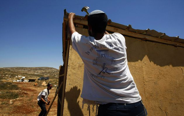 Nahalat Yosef Rises Again: Jewish settlers rebuild a house in the West Bank outpost of Nahalat Yosef on June 1, after it was destroyed by Israeli security forces.
