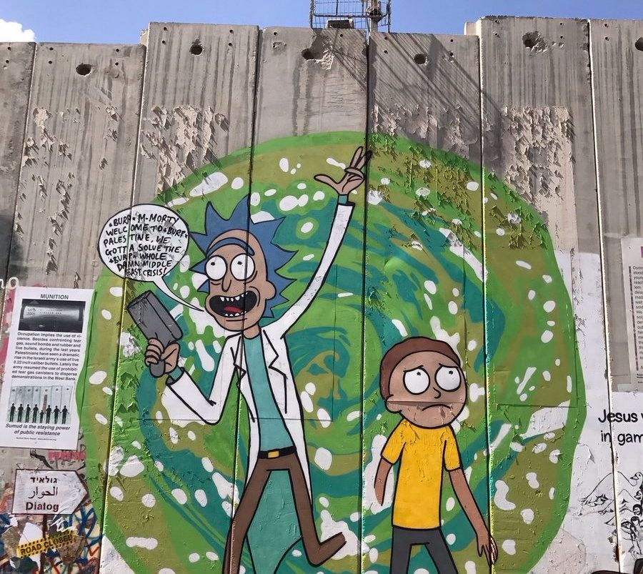 Australian graffiti artist Lushsux painted the cartoon characters Rick and Morty on the West Bank separation barrier.