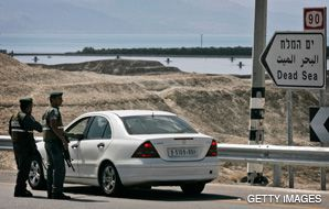 NO VACATION: A Palestinian car is turned back before reaching the Dead Sea. The closures are prompting questions about security and business interests.