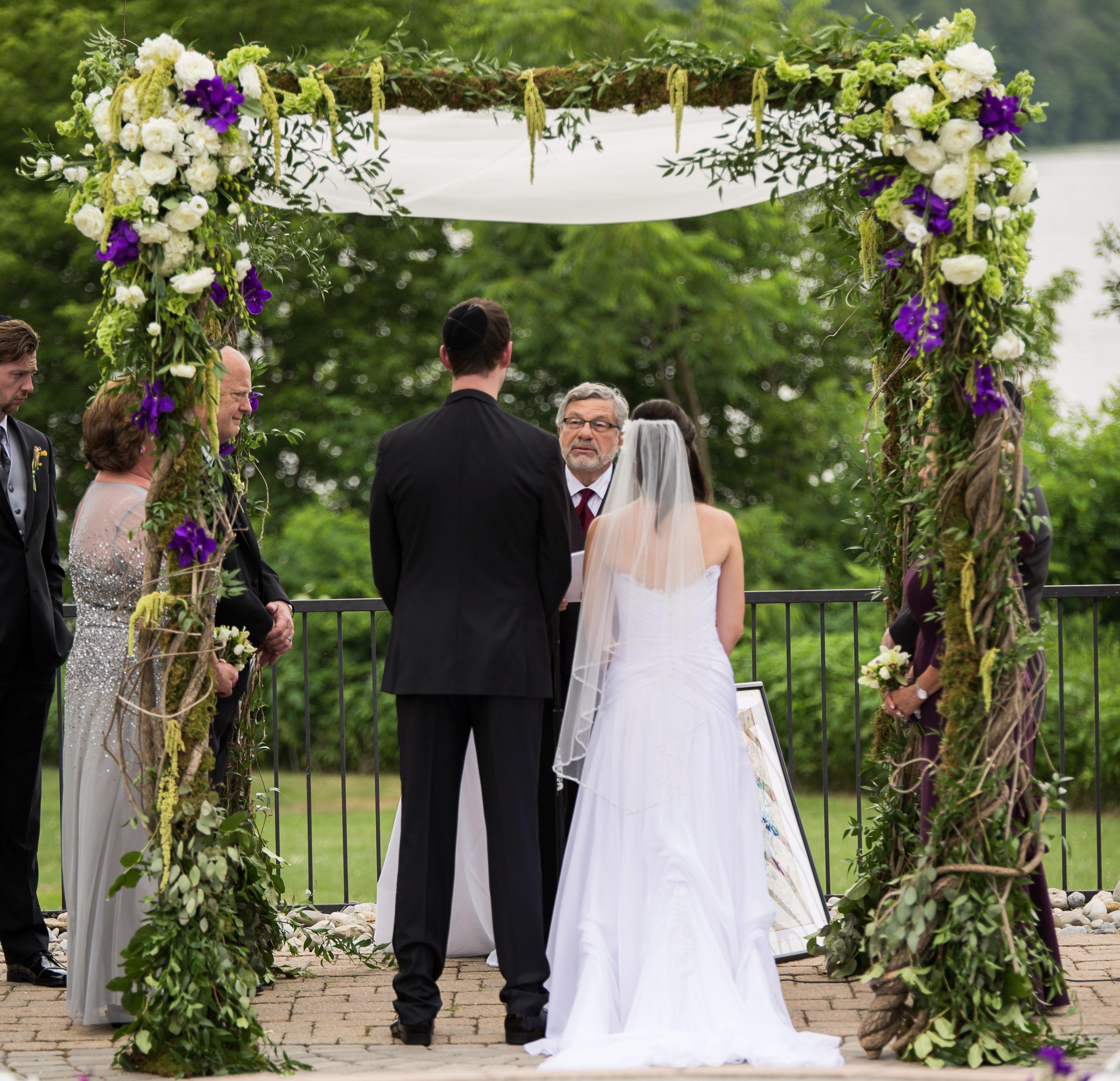 Rabbi Seymour Rosenbloom officiates an intermarriage.