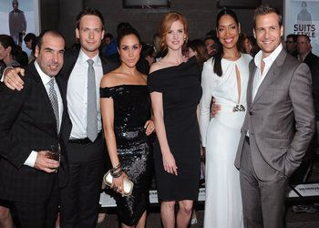 (L-R) Rick Hoffman (Louis Litt), Patrick J. Adams (Mike Ross), Meghan Markle, Sarah Rafferty, Gina Torres and Gabriel Macht (Harvey Specter) of ?Suits? at a USA Network event.