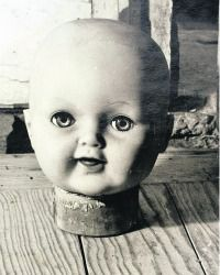 Eerie Head: Kati Horna?s ?La Muneca? depicts a doll?s head resting on the floor.