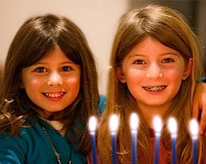 The Quasi-Jewish Grandkids: Van Gelder?s grandchildren, Julia, left, and Rebecca, celebrate Hanukkah.
