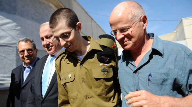 Home for Good: Beaming father Noam Shalit walks with son, Gilad Shalit, as the soldier enjoys his first day of freedom after five years in captivity.