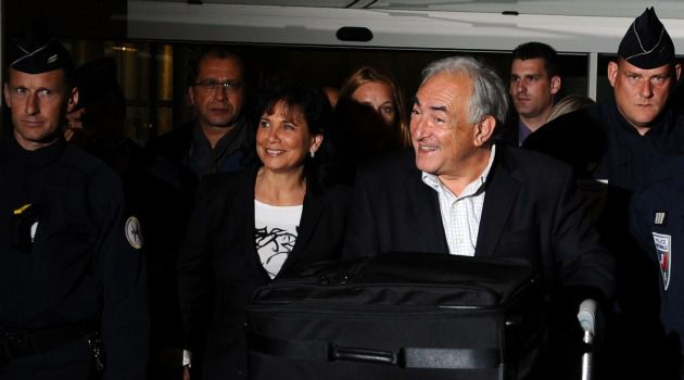 Set Up for Fall? French banker Dominique Strauss-Kahn arrives in Paris after being cleared of sex abuse charges.