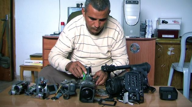 Two Eyes, ?5 Cameras?: An unusually candid window on Palestinian life under occupation has won an Oscar nomination. It debuted to cheers in Ramallah.