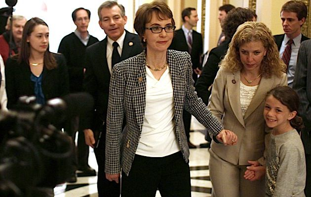 Hand in Hand: Gabrielle Giffords, center, who resigned from Congress on January 25 to focus on her recovery, walks with her friend Rep. Debbie Wassserman Schultz.