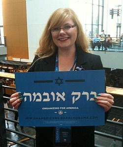 Volunteer holds Obama campaign sign in Hebrew.