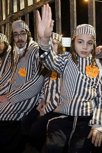 Ultra-Orthodox Jews wore yellow stars and concentration camp outfits at a rally in Jerusalem.