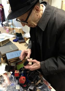 Hunting: Avraham Chaim, who has lived nearby since 1948, browses through marked-down merchandise at Israel Judaica, which may soon close.