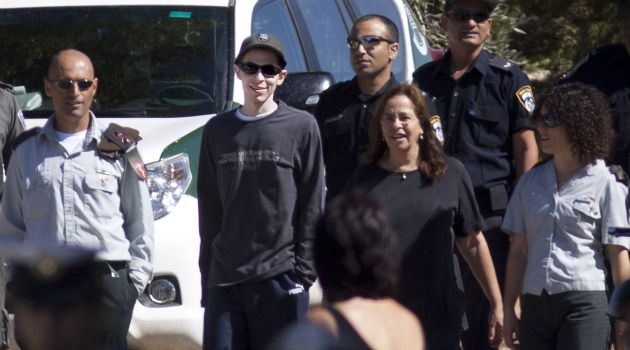 Morning Stroll: Newly released soldier Gilad Shalit went for a walk with his mother, Aviva, outside their home in northern Israel.