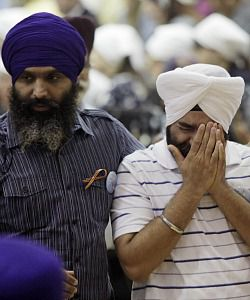 Mourning: Sikhs in Wisconsin mourn after the shooting rampage carried out by a suspected white supremacist.