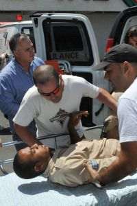 Giving Aid: A victim of the terror attacks is carried on a stretcher to a hospital in Eilat.