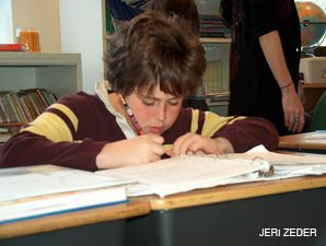 TAKING NOTE: JCDS fifth grader Sam Sano writes in his notebook ? in Hebrew
