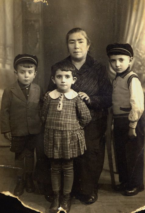 Samuel Birger with his cousins and grandmother Shifra Berger.