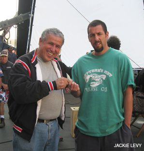 CASHING IN: Roni Levy, left, collects on a bet with Adam Sandler.
