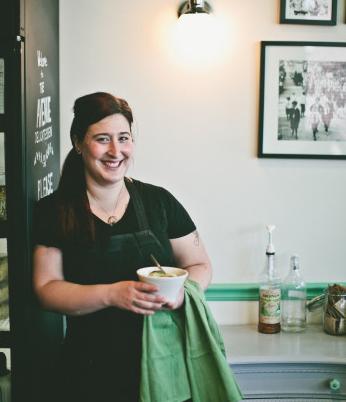Laura Frangiosa, owner of The Avenue Delicatessen in suburban Philadelphia, holding her signature Jewish wedding soup.