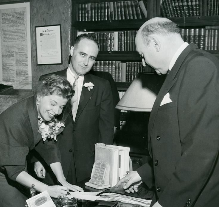 Mazel Tov: Jean Dubinsky, daughter of the International Ladies' Garment Workers' Union President, marries Air Force veteran Shelley Appleton. The couple were married in the presence of their families at a ceremony performed by Dr. Israel Goldstein (above right), rabbi of congregation B'nai Jeshurun in New York.