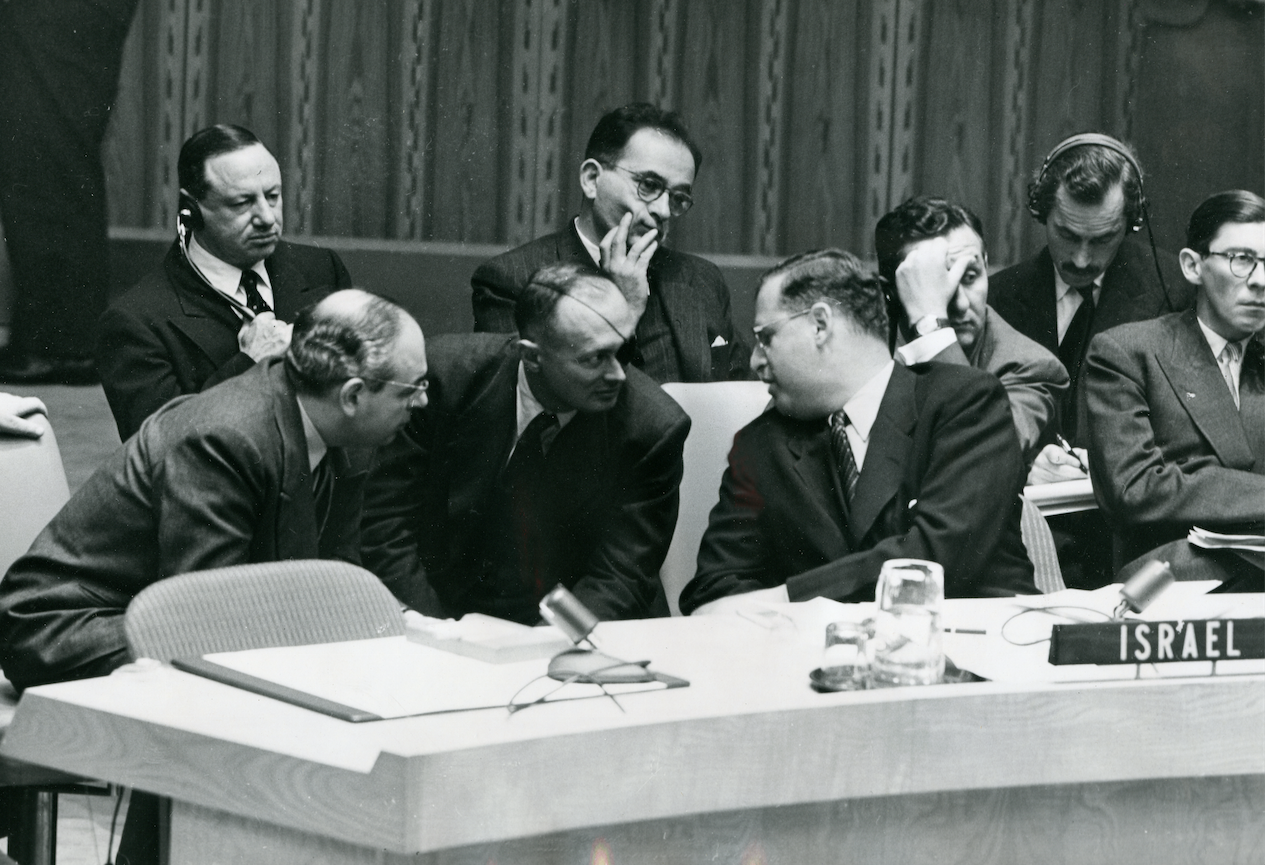Huddle: Israeli delegates at the United Nations Security Council took up the matter of the Israeli-Arab crisis. Front row left to right: Emile Najar of the Israeli Foreign Ministry; General Moshe Dayan and Abba Eban. Eban spoke for Israel and objected to a proposal, submitted by the Pakistani delegate, that Israel halt its canal construction on the Syrian border.