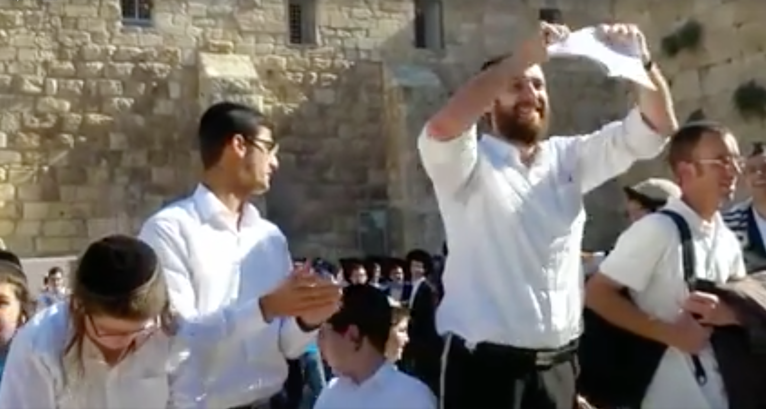 An ultra-Orthodox man rips up a progressive prayer book in protest.