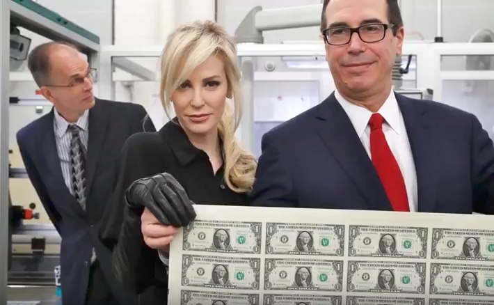 Treasury chief and wife pose with money
